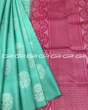 Handloom light weight silk saree in torqoise green shade body with paisley motif in silver zari