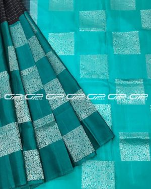 Handloom light weight pure silk saree in teal shade body with geometric and checked motif in silver zari