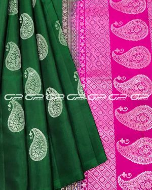 Handloom light weight pure silk saree in bottle green shade body with paisley motif in silver zari